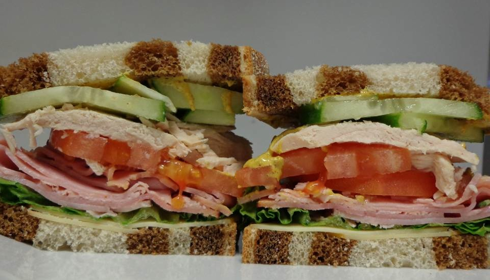 The Buccaneer sandwich from Ken's in Bedford, Mass. with Virginia ham, oven roasted turkey, smoked Gouda cheese, lettuce, tomato, cucumbers and Dijon mustard.