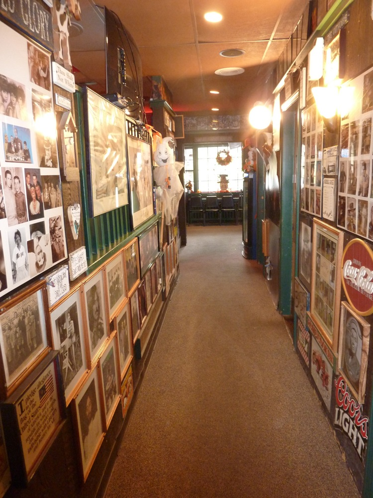 Walls lined with photos and collectibles at the Nashoba Club Pizza Restaurant in Ayer, Massachusetts.