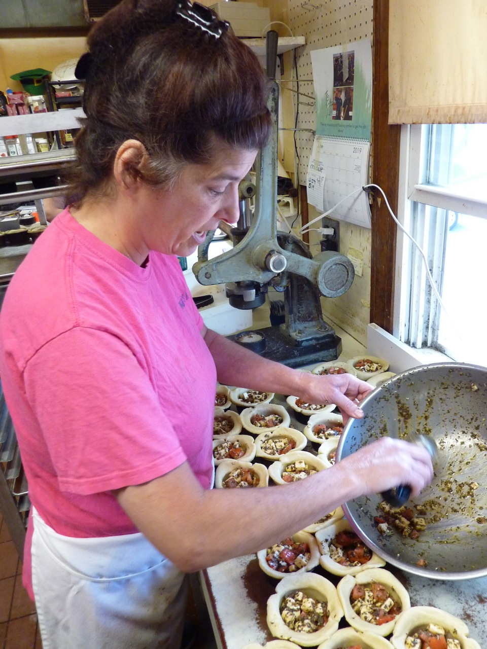 Michelle Rothwell makes a Tomato Job Pie (a Caprese salad put into a pie) at Thwaites Market in Methuen, Mass.