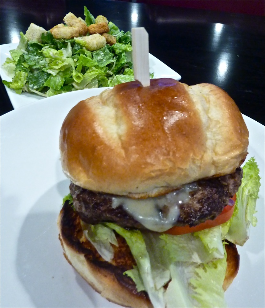 Chuck/short rib blended burger with a Caesar salad at Barrett's Alehouse in West Bridgewater, Massachusetts.