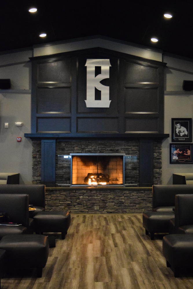 Fireplace area with sofas at Barrett's Alehouse in West Bridgewater, Mass.