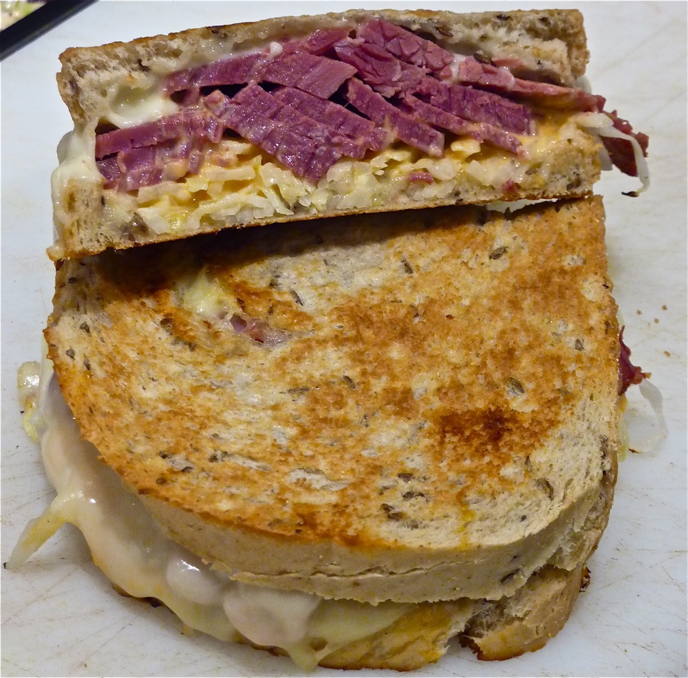Pastrami sandwich with cheddar cheese, onions and horseradish sauce on rustic bread from Beantown Pastrami Co. in Boston.
