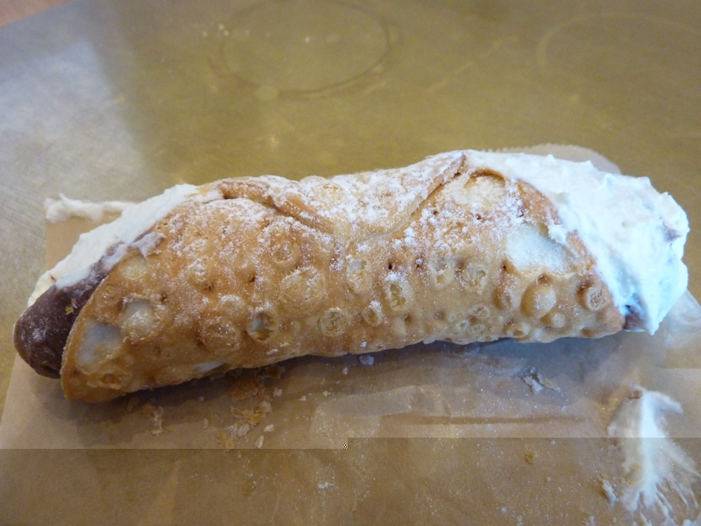 Handmade black and white cannoli from the Cannoli Station at Eataly Boston