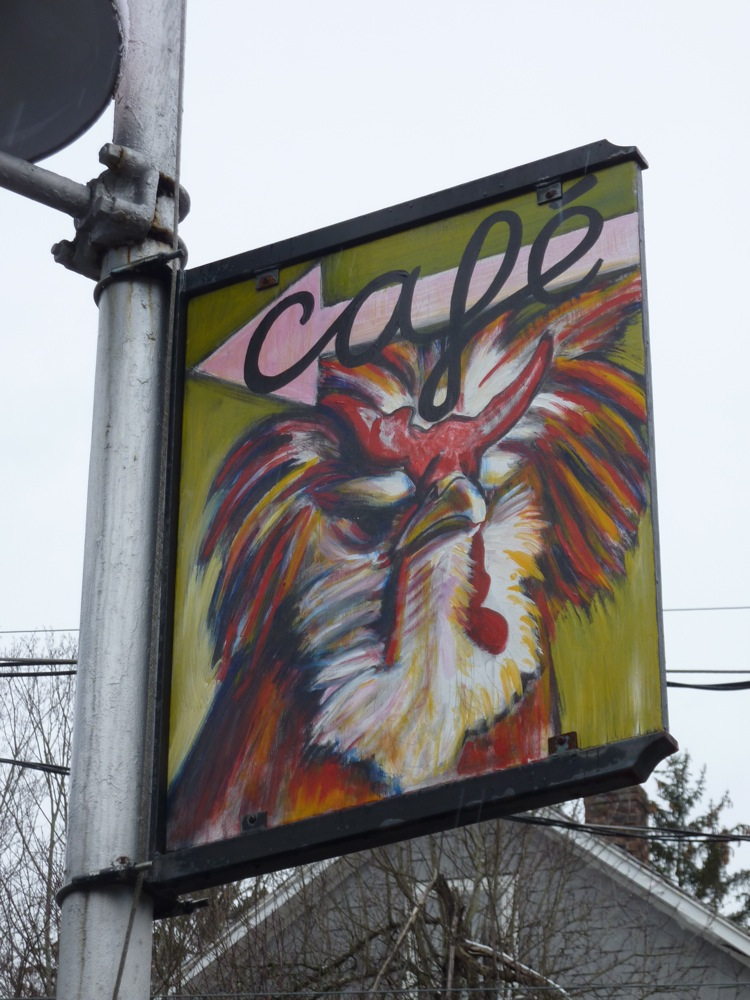 Rooster sign just outside Cushman Market and Cafe in North Amherst, Massachusetts.