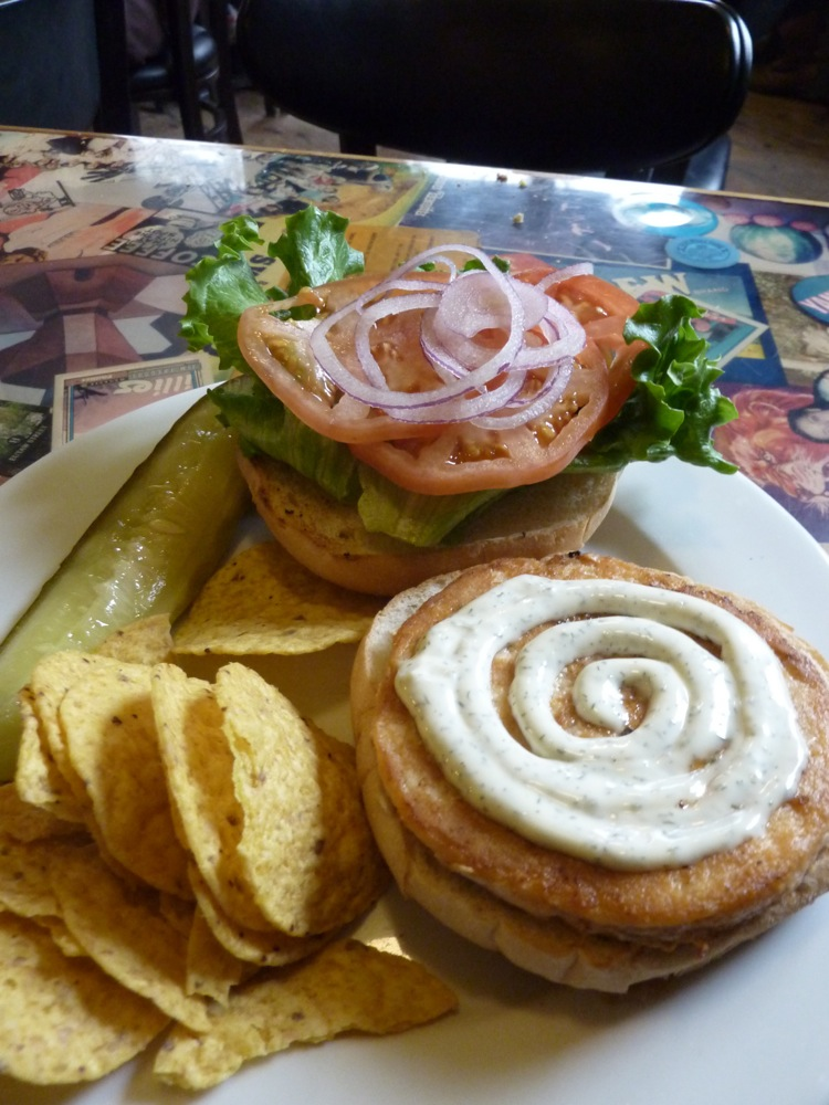 Salmon burger with wild caught Alaska salmon, luttuce, tomato, red onion and lemon dill mayo sauce on a roll from Cushman Market and Deli in Amherst, Mass.