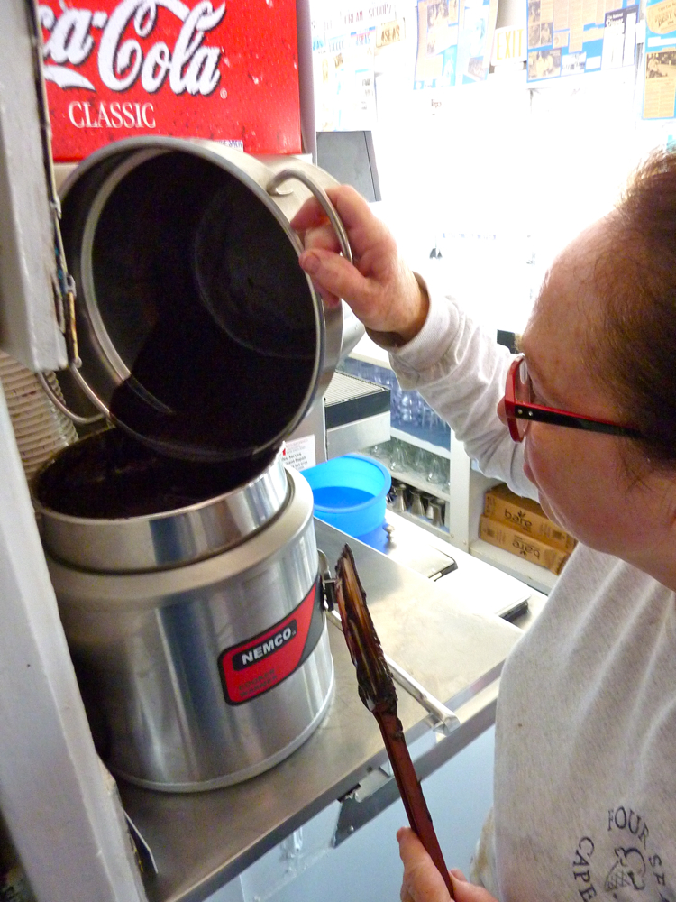 Peggy Warren makes hot fudge at Four Seas Ice Cream in Centerville, Mass.