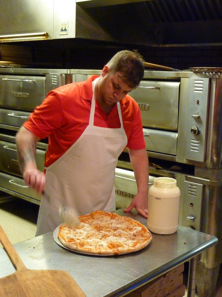 Beau Ramunto creates authentic New York pizza at Granfanallys Pizza Pub in Salem, N.H.
