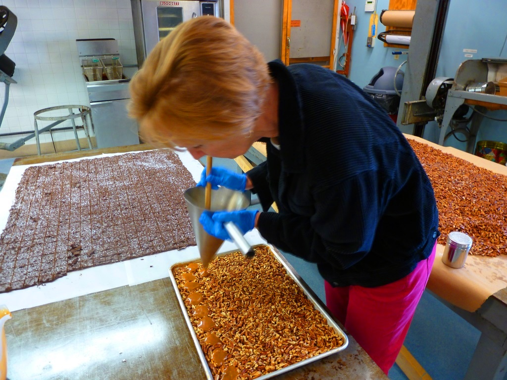 Nicole Heisey creates candy in the kitchen at Len Libby Candies in Scarborough, Maine.
