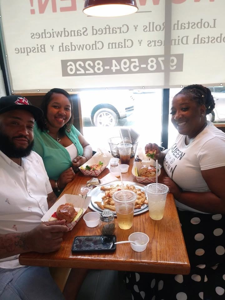Guests from Clevland, Ohio, stop in to try some local food at Lobstah On A Roll in Boston, Mass.