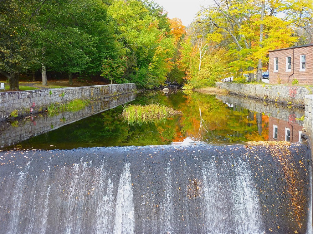 A waterfall and foliage in downtown Peterborough NH.
