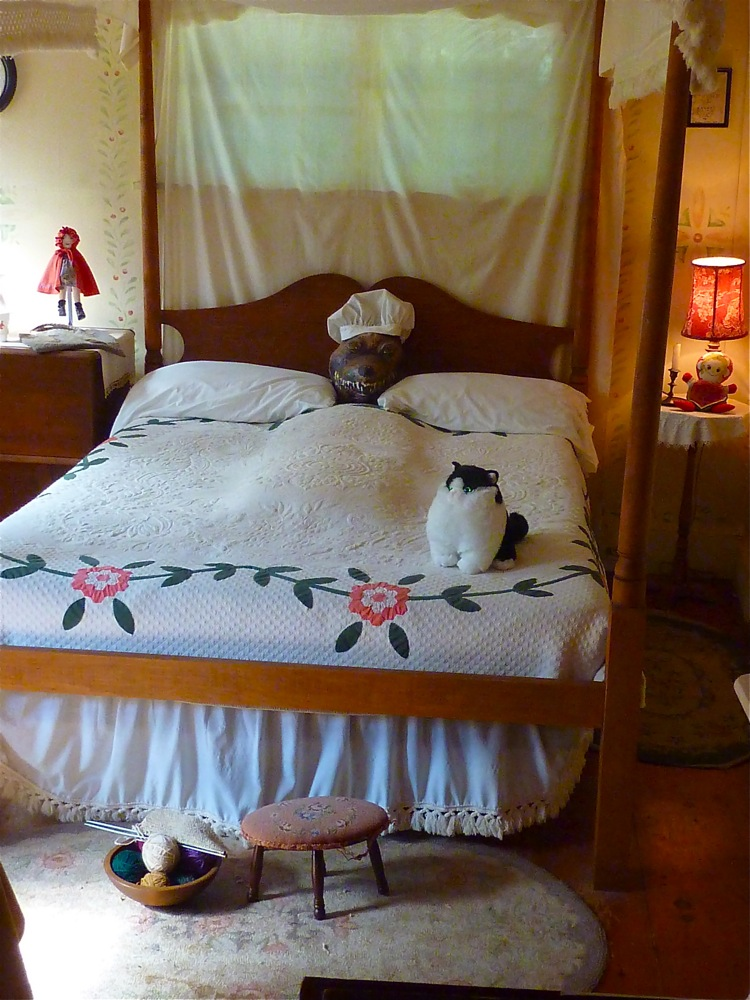 Wolf under covers at Little Red Riding Hood Museum at Pickity Place in Mason, N.H.
