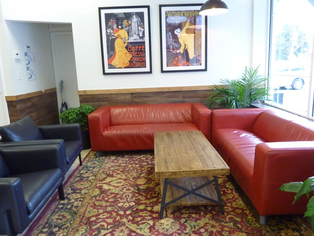 Comfy sofa section at Red Cherry Cafe in Walpole, MA.