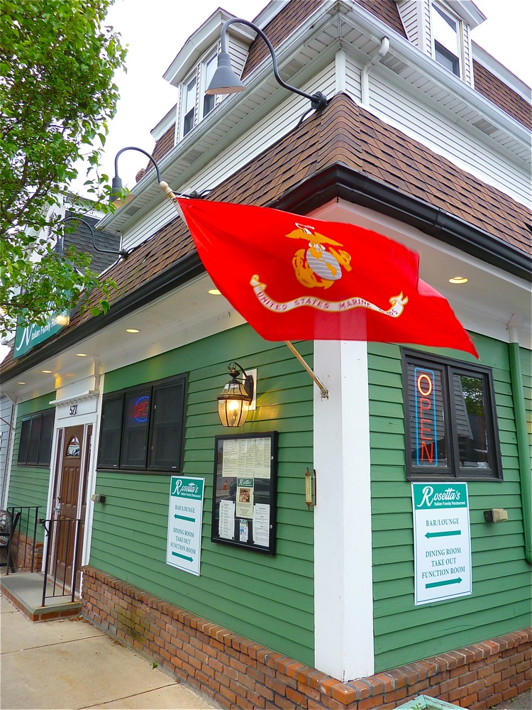U.S. Marine Corps flag waves in front of Rosetta's Italian Restaurant in Canton, Mass.