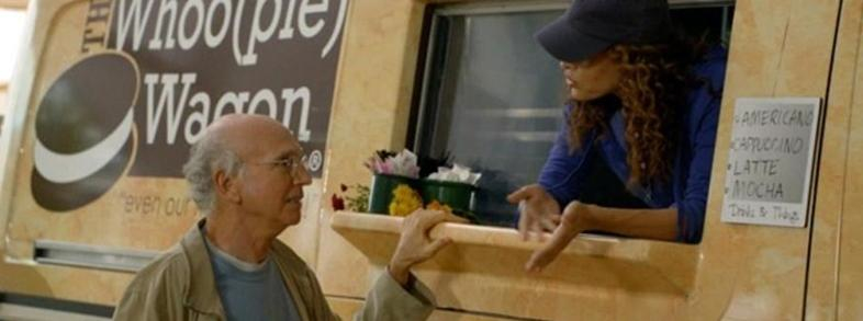 Larry David buys a whoopie pie from The Whoo(pie) Wagon at the Topsfield Fair in Topsfield, Mass.