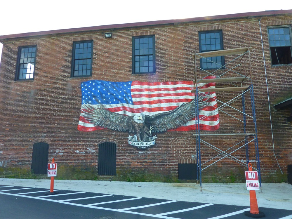 Winsmith Mill Market flag design on building in Norwood, Mass.