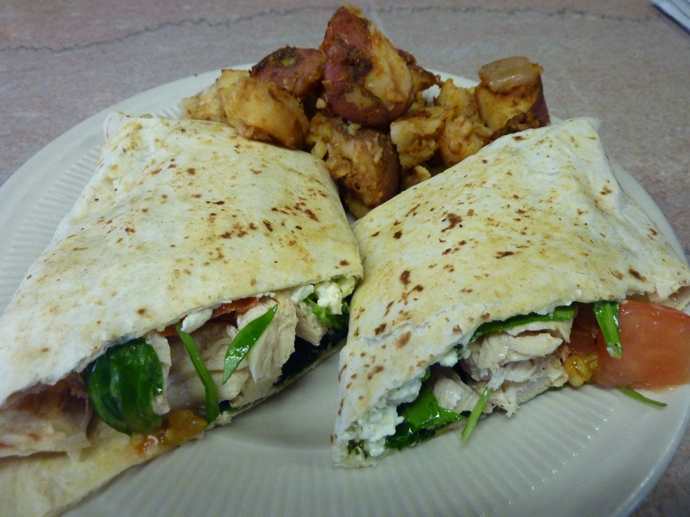 Chicken and cheese wrap with home fries from the Yankee Diner in Charlton, Massachusetts.